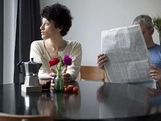 Couple at table - Halfdark/Getty Images
