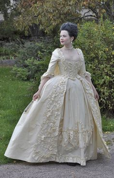 Before the Automobile: 1760s robe à la Française. Not only did she hand sew every stitch she is wearing; she always does the appropriate hairdo, too