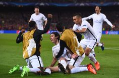 Paris Saint-Germain's Uruguayan forward Edinson Cavani (C down) celebrates with teammates after scoring their first goal during the UEFA Champions League round of 16 second leg football match FC Barcelona vs Paris Saint-Germain FC at the Camp Nou stadium in Barcelona on March 8, 2017. / AFP PHOTO / Josep Lago