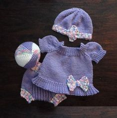 Free knitting patterns for baby set with dress, diaper cover, ball, and hat