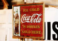 "Twenties vintage Coca Cola sign ""Ice Cold Coca-Cola In Bottles"" featuring 1923 Christmas Coke bottle by American Art Works of Ohio circa 1931. Condition as shown. Dimensions 29"" x 21. FREE SHIPPING"