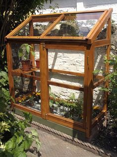 Homemade greenhouse up against the house: