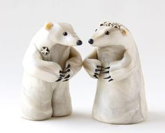 This one of a kind pair of polar bear figurines are dressed for a wedding. Description from etsy.com. I searched for this on bing.com/images
