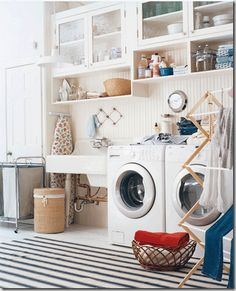 This laundry room appeals to me. I'm not a perfectionist, I like things whimsical & lived in.