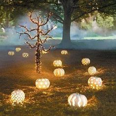 you can get these plastic/paper pumpkins at the craft store and cut designs in them with a thin box knife or razor blade, then put a tea light in them. <3