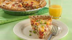Bacon, tomato & onion quiche - think I would trade out carmelized onions for the green onions in this one