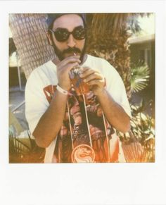 The Arab Parrot sips poolside at Noise Pop Oasis's Coachella 2012 fete, hosted by Prism's designer Anna Laub.
