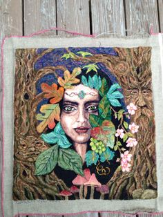 An adaptation of Loretta Scena's pattern The Green Woman. Hooked by Dana Psoinas.