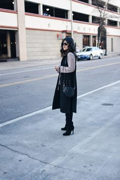Winter fashion. Look of the day featuring a long black vest via VIPme, American Eagle dark skinny jeans, Over the knee high boots, and Rayban aviator sunglasses