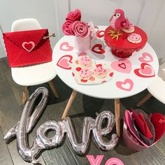 Live Love Blank www.liveloveblank.com Valentines day for Children Ideas Presents, red and Pink Hearts, Modern Eames Table and Chair set for child kids Perfect kids table tablescape for valentines day cake stand love sign, valentine card holder white table and chair set contemporary children dining table pink and red dress for little baby girls holiday ideas, children's parties holidays events