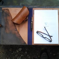 #folio from the inside. The raw edge is the edge from the tannery. Did a #rustic #patina. Shown with #sailorpen from #japan. FYI, awesome pens from this company. Also shown, #clairefontaine paper. Amazing papers from #France.  #documentholder #rusticelegance