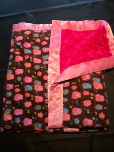 owl on one side and pink rose cuddle on the other. perfect blanket for that baby, toddler or young girl!