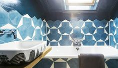 Blue patterned bathroom with a skylight.