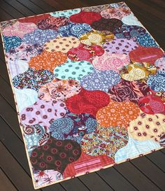'Sew' Colorful and lovely #quilt - love the way she plays with these blocks to create new patterns