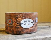 brown leather cuff with flowers ... LET IT SHINE