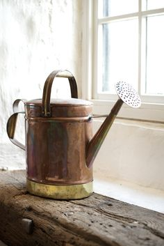 antique copper watering can available at Cotes Mill.