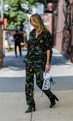 NYFW: The Best Fall Outfits from the Spring 2017Runway Shows   Street Style   New York Fashion Week   Tropical print pantsuit + ankle boots
