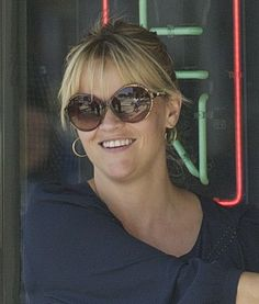Reese Witherspoon rocks a knotted bun with bangs