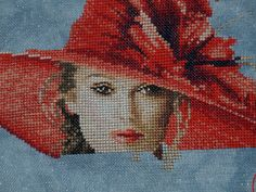 """I am almost finished w/ this design by John Clayton called """"Victoria"""".  It is beautiful.  The detail in the face is really amazing. It's like looking at a photograph. I think I will stitch a poster of the Titanic voyage to display w/ it on the wall."""