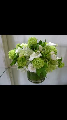 Green and white centerpiece flowers