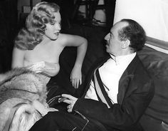 Groucho Marx (October 2, 1890 – August 19, 1977) and Marilyn Monroe on the set of 1949's Love Happy