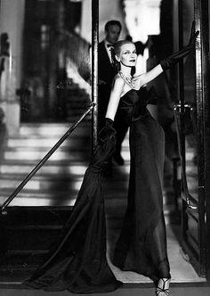 Sunny Harnett (in an evening gown by Lanvin-Castillo) photographed by Richard Avedon at the Hôtel San Régis, Paris - August 1954