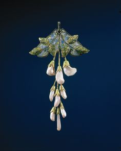 Pendant of gold, pearls and enamel, in the form of a branch wisteria. Created in the Art Nouveau style. Courtesy of Rijksmuseum http://www.europeana.eu/portal/record/90402/5E5705C871F1D95B5C325E1BF6200B1E717F85EA.html