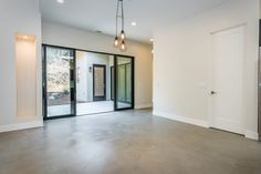 Western Sliding Doors / Concrete Floors / Sherwin Williams Paint 7011 Natural Choice