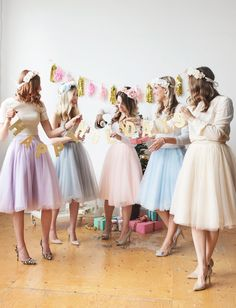 Pastel tulle skirts, heels and floral crowns. The perfect pink holiday celebration with my blogger girlfriends. #pasteldressparty