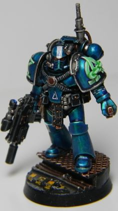 Page 16 of 20 - Word Bearers...plus allies. BT Emperor's Champion 25/4/15 - posted in + WORKS IN PROGRESS +: This is - by far - the best AL marine Ive ever seen. The use of metallic colors blends green and blue far better than any matt scheme. Awe.some.