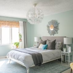Really liking the chandelier. A bright and minimal master bedroom with lots of DIY touches.