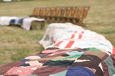 fall farm wedding - ceremony seating was quilts on hay bails
