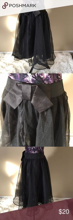 ⭐️EUC Bellino USA Black Tulle Skirt fully lined ⭐️EUC Bellino USA Black Tulle Skirt with full lining. This is marked as a size XL, but it fits smaller - I have included measurements to help you out. Approximate measurements are: waist - 15.5, length - 28. Comes from a smoke-free home and ships in one business day, thank you! Bellino Clothing Skirts
