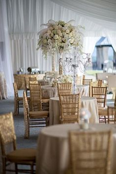 Gold and white themed Gatsby-themed reception - love the towering centerpiece #wedding #reception #gold #gatsby #tablescape