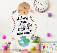 A fun wall sticker that is ideal for decorating kids bedrooms. A sweet wall quote with a rocket flying between the earth and the moon leaving behind a trail of hearts. Are you looking for something a little bit different to decorate your home? This quirky wall sticker is ideal for adding a unique touch to any room. A great illustration that kids will love, complete with a calligraphic text with the words; 'I love you to the moon and back'.  #WallSticker #Decoration #Love