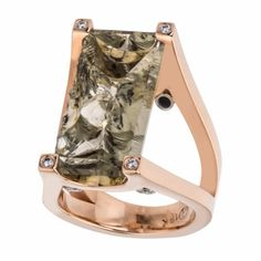 18kt red gold ring featuring a smokey Quartz that is naturally cleaved and prong set.  The total weight of the Quartz is 11.76ct.  There are 8 round brilliant Diamonds set on the prongs and underside of the split v shank with a total weight of .14ct.  This is a Jorge Adeler custom design.