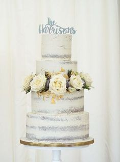 Featured Cake: Juniper Cakery; Elegantly unique silver detail white wedding cake