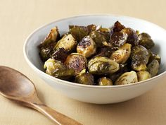 Roasted Brussel Sprouts by Ina Garten: Time honored, very easy with extra virgin olive oil and salt.