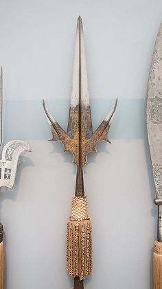 Chauve-Souris | Italian | The Met Date:ca. 1510–30 Culture:Italian Medium:Steel, gold, wood, textile Classification:Shafted Weapons Credit Line:Bashford Dean Memorial Collection, Gift of Edward S. Harkness, 1929 Accession Number:29.156.39
