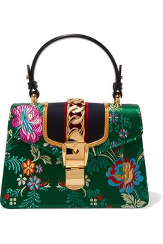 Multicolored jacquard, black leather Push clasp-fastening front flap Made in Italy