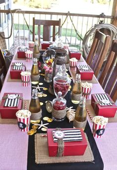 Pirate birthday party... bottles of root beer or cream soda would be fun! Favor boxes at each child's seat. Cute!