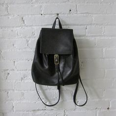 {Coach} Black Leather Backpack 100% authentic.  Minimalistic chic Coach black leather backpack with a clean interior.  Gorgeous condition. Coach Bags Backpacks