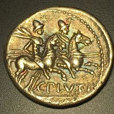 Reverse of a beautiful 121 BC Rome C. Plutius AR Denarius with nice rainbow tones around the horseman. Dioscuri riding right & lettering is C PLVTI.