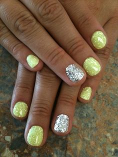 Summer nails, yellow  silver glitter. Love! #nails #yellow What is it with the ring finger being painted different?  Seen this alot lately! #colourfulnails