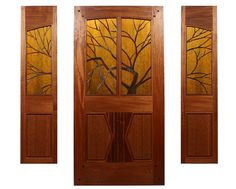Deisigned by Brian & Zoleta Lee Designs, The Eagle River Entry.  Made of Ribbon Grain Mahogany with tiffany style foiled stained glass and chip carved Old Growth VG Redwood Panels.