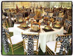 Traditional african wedding decor. Zulu wedding. Wedding ideas. Wedding centerpieces. Luxurious animal prints. Hand painted jugs. Tiffany chair tie backs. Lounge furniture. www.secundatents.com