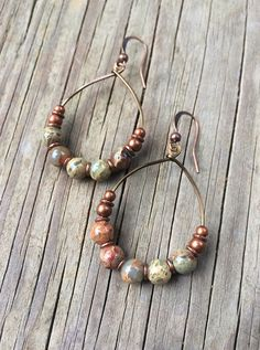 Gorgeous African opals on a hammered, antiqued copper hoop with copper accents. African opals are beautiful natural stones that vary with blues, reds