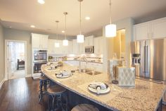 Inviting gourmet kitchen with large island.