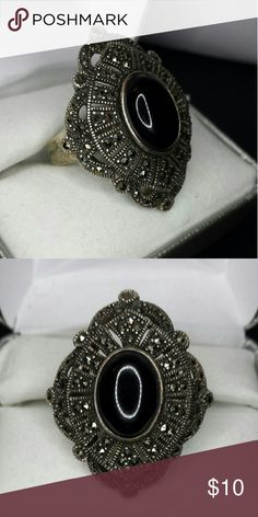 Black stone statement ring Intense black oval stone set in a victorian style trim. Vintage! Possibly a statement thumb ring. Size: 22mm diameter, most likely a size 11-12 MAKE ME AN OFFER, I DO BUNDLE DEALS!!! unbranded  Jewelry Rings