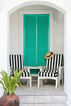 Sophisticated porch with gorgeous lounge chairs.